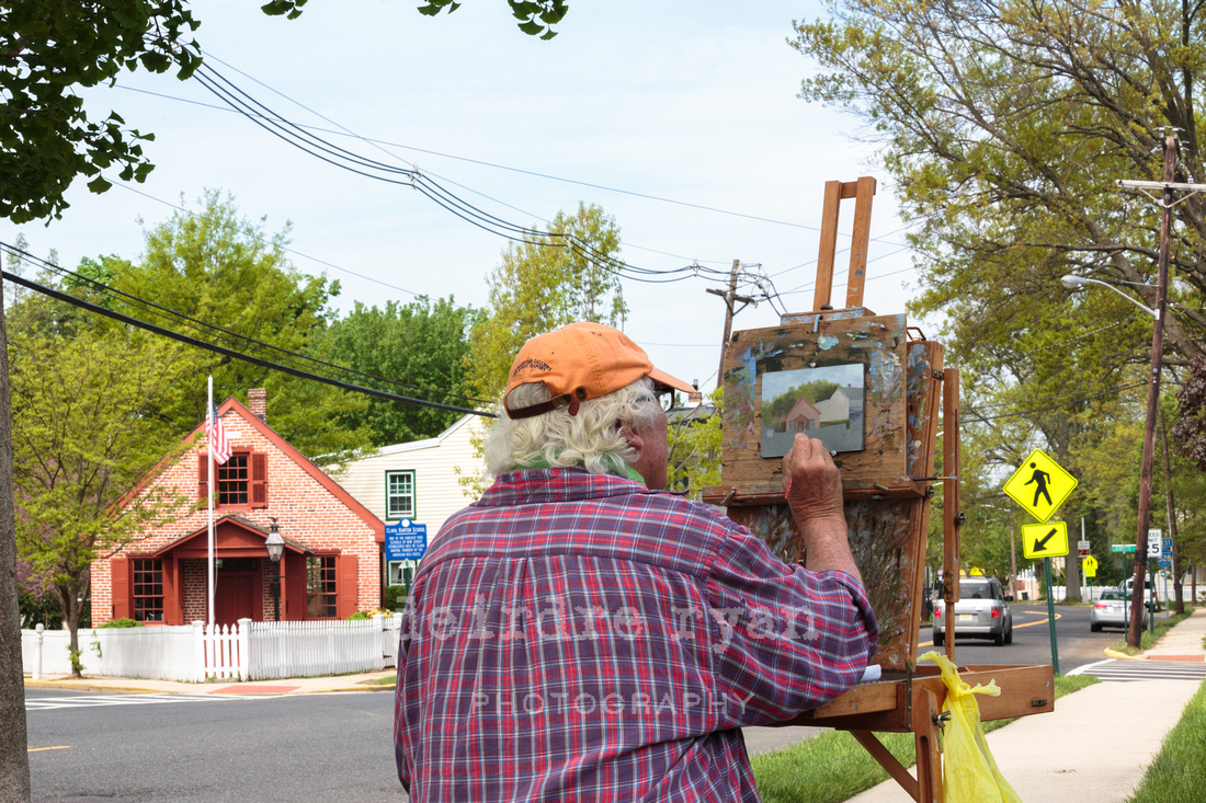 Local artist, Al Barker of Bordentown City, paints the Clara Barton Schoolhouse.